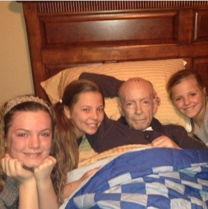 My three girls and their grandad in his final hours.